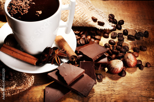 Printed kitchen splashbacks Chocolate cup of hot chocolate, cinnamon sticks, nuts and chocolate