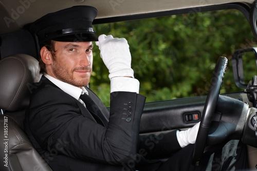 Confident chauffeur in elegant automobile Fototapeta