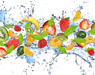 Obraz Fresh fruits in water splash, isolated on white background