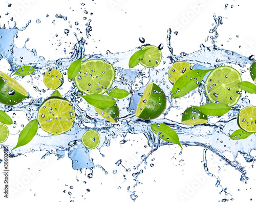 Fresh limes in water splash,isolated on white background - 38602855