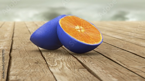 Valokuva  blue skin orange on wooden table