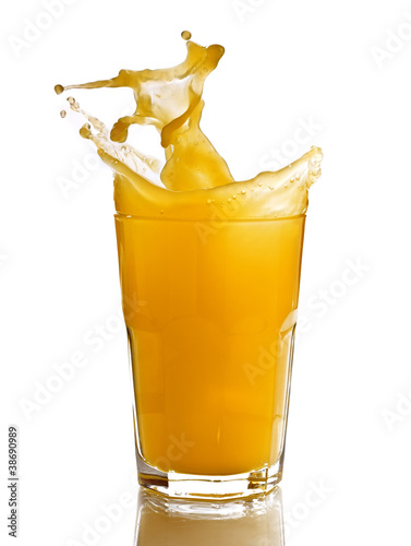 Foto op Aluminium Opspattend water Orange juice splash in a glass, isolated, white background