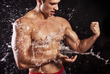 muscular man having shower