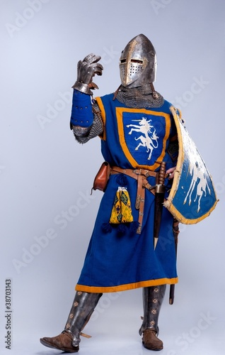 Foto op Canvas Piraten Medieval knight on grey background.