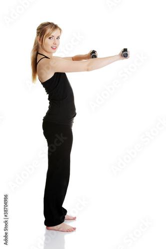 Plakat Młody atrakcyjny żeński ćwiczenie używać dumbbell
