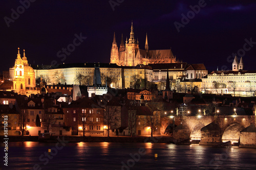 In de dag Volle maan View on Prague gothic Castle with Charles Bridge in the Night