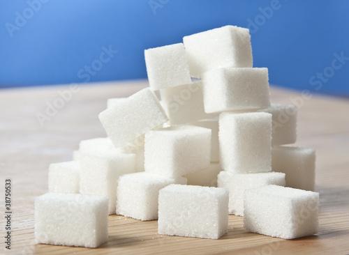 Fotografie, Obraz  sugar cubes on wooden table