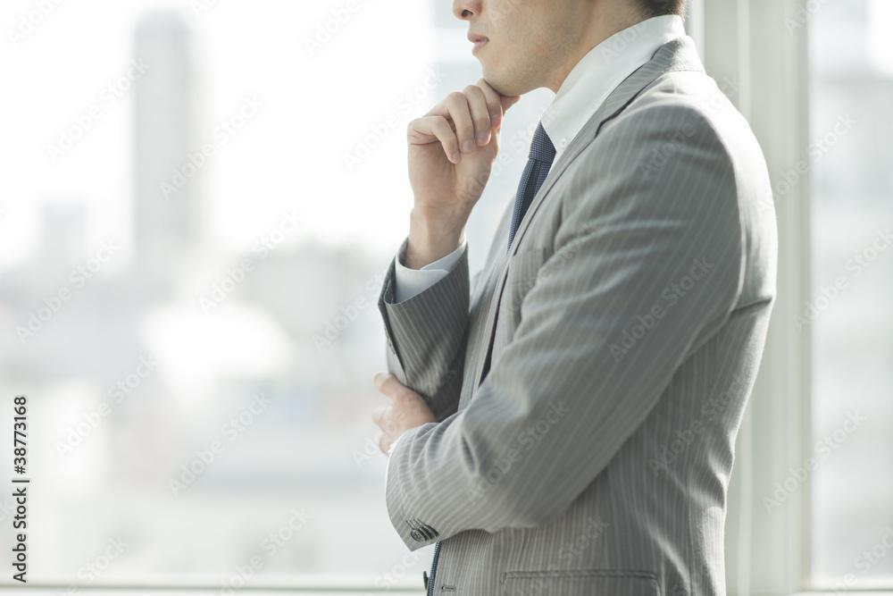 Fototapeta 考えるビジネスマン