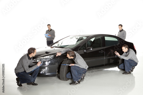 Insurance agent looking at car Canvas Print
