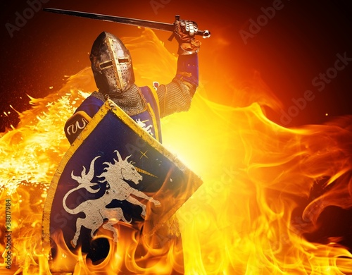 Canvastavla Medieval knight in attack position on fire background.