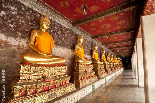 Golden buddhist sculpture in meditation action Poster