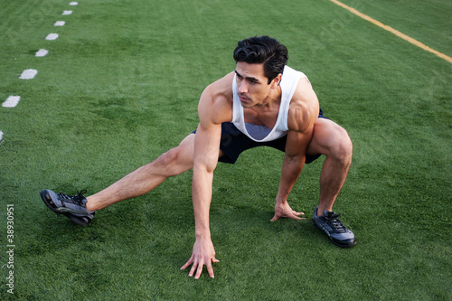 Fotografie, Obraz  Handsome, young latino athlete stretching