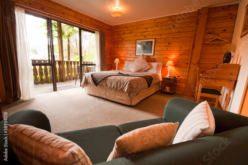 Photo Interior of mountain wooden lodge bedroom