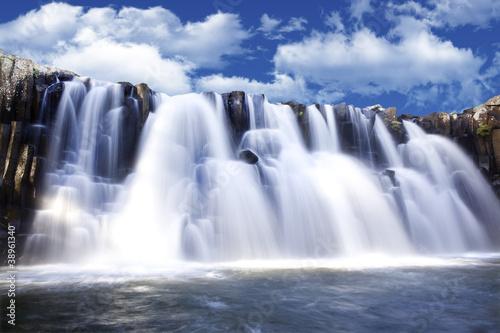 Foto op Canvas Watervallen Beautiful watterfall with clear blue sky in background