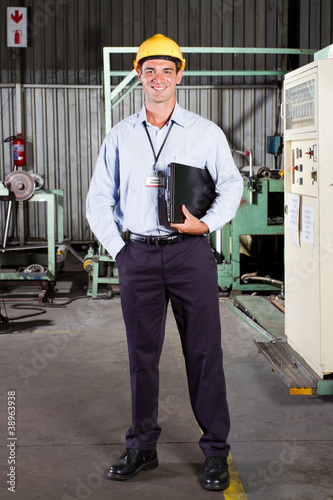 Fototapeta full length portrait of factory technical manager obraz