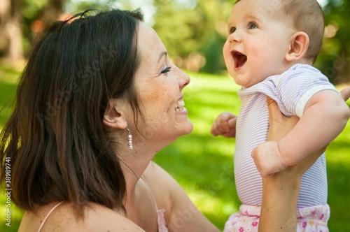 Fotobehang School de yoga Happy mother with her smiling baby