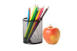 colour pencils in a black holder with apple