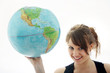 canvas print picture - Junges Maedchen mit Globus