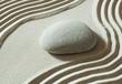 zen pebble isolated on sand