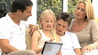 Young Caucasian Family Having Fun with Wireless Tablet