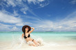 Happy fashion woman on the beach