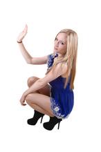 Girl Croaching On Floor.