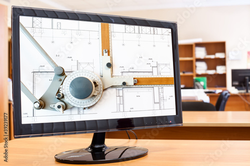 Computer monitor with blueprints and drawing board on desktop Canvas Print