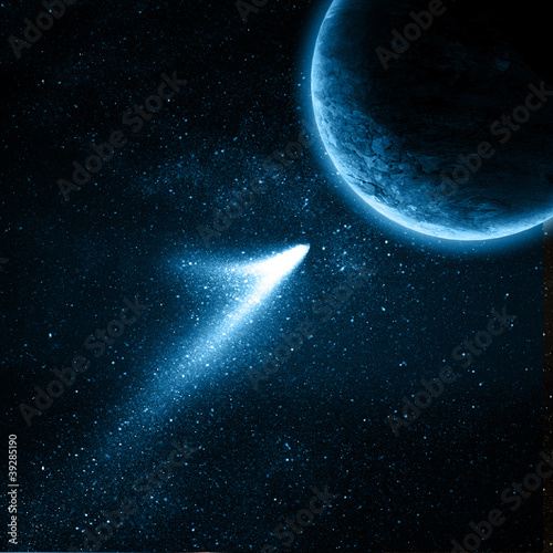 Obraz comet flying to planet in space - fototapety do salonu