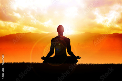 Silhouette of a man figure meditating in the outdoors - 39327285