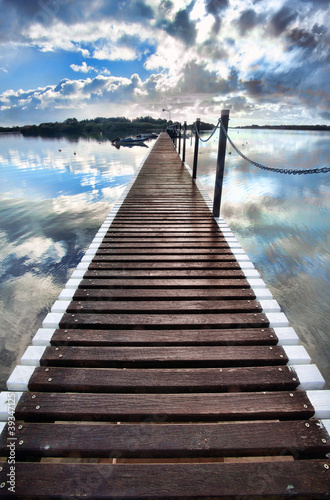 Tuinposter Pier long pier into water