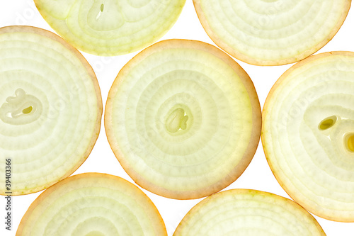 Fotobehang Plakjes fruit Slices of fresh Onion / background / back lit