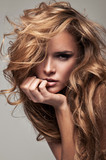 Vogue style portrait of delicate blonde woman