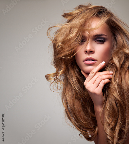 Obraz Portrait of delicate blonde woman with copy space - fototapety do salonu