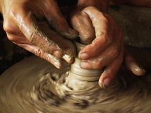 Close-up Of Potter Turning A P...
