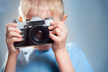 Child With A Camera