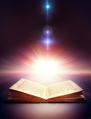 ancient open book with magic light