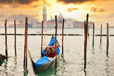 Gondola at sunset pier near in Venice, Italy - 39485776
