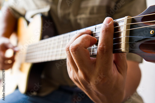 Playing guitar F chord - Buy this stock photo and explore similar ...