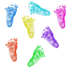 Imprints Of Baby Feet On White Background