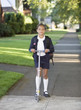 Portrait of girl in school uniform with scooter