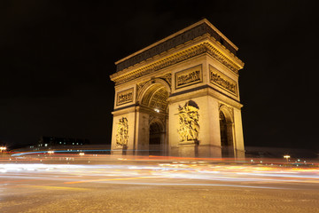 Fototapeta na wymiar Arc de Triomphe - Arch of Triumph by night in Paris, France