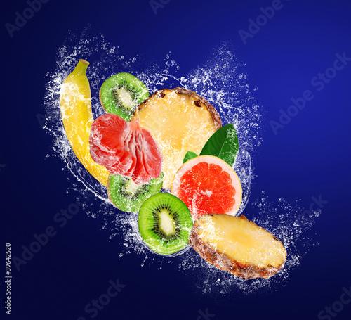 Fototapety, obrazy: Assortment of sliced tropical fruits