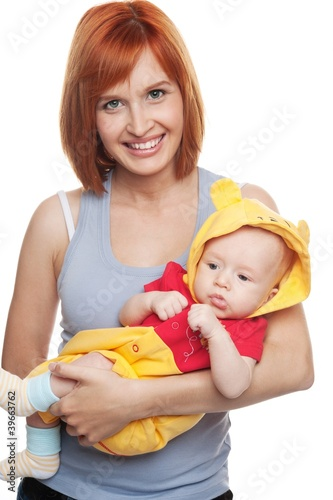 Photo  Redhead woman with child in funny costume.