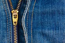 Close Up Of A Zipper Over Blue Denim