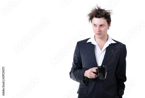 Fotografie, Obraz  Tired businessman holding cup of coffee