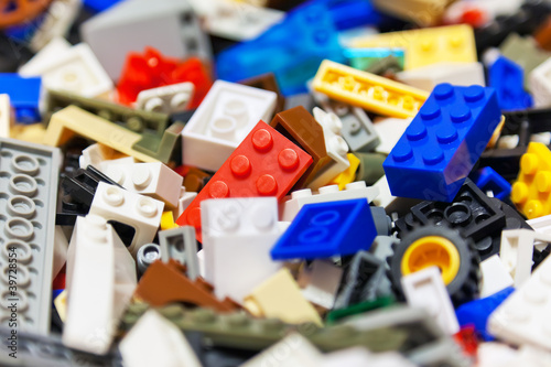 Heap of color plastic toy bricks Poster Mural XXL