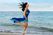 The woman runs on sea coast