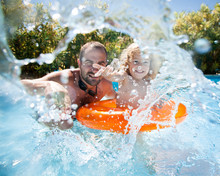 Child With Father In Swimming ...
