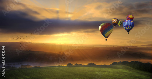 Tuinposter Ballon Stunning sunrise of hot air balloons over South Downs landscape
