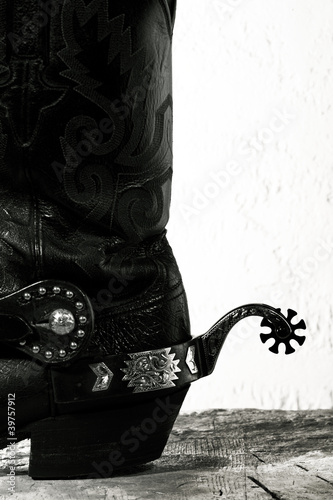 Fotografia, Obraz  Old-fashioned western still life with old cowboy shoes ans spurs